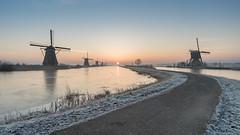 In between sunrise at Kinderdijk (Rob Schop) Tags: f11 wideangle zonsopkomst alblasserdam landscape winter sonya6000 molens nederland outdoor groothoek hoyafilters samyang12mmf20 ice windmill rijp sunrise a6000 kinderdijk hdr bracket