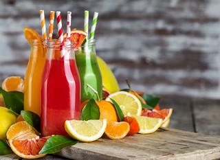 Orange, blood orange juice and lemonade background