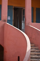 THE DOOR TO THE SLAVE SHIPS FOR 20 MILLION PEOPLE.  (300 YEARS AGO)   MANY FOR THE NEW WORLD. .  SENEGAL,  AFRICA (vermillion$baby) Tags: goreeisland slaveprison slavetrade windowdoor door senagal slave stairs line curve color composition senegal africa architecture structure building angle old house ocean prison dakar westafrica