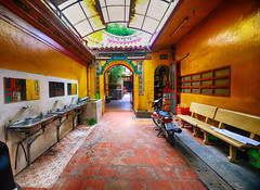 Colorful Temple in Ho Chi Minh City, Vietnam (` Toshio ') Tags: toshio hochiminhcity vietnam saigon architecture asia history religion pagoda cholon sink bench doorway colorful scooter skylight