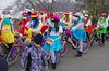 Masked biker gang (Jumpin'Jack) Tags: young women girls riding bicycles wearing vivid bright vibrant colourful colorful frilly clothes skirt dress hats veil masks wigs street biker gang shrovetide pust endof winter celebration snow
