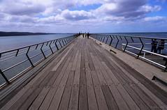 pier (amazingstoker) Tags: lorne victoria australia pier sea horizon perspective vanishing point wood boards railings fence clouds sky great ocean road water