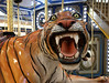 Mall Tiger (cowyeow) Tags: weird usa america us creepy art sculpture statue gardencenter big huge giant christmas decoration losangeles california carousel fierce tiger teeth mouth scary ride