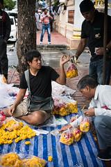 Man Selling Floral Offerings (Thailand) (tetzuOzawa) Tags: offering flower yellow bangkok thailand streetphotography