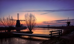 Dutch winterscape (reinaroundtheglobe) Tags: kinderdijk zuidholland holland thenetherlands netherlands dutch dutchlandscape traditionalwindmill windmills mills sunrise landscape nopeople traveldestination touristdestination colorfulsky