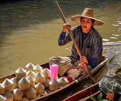 Coconut drink vendor (FotoGrazio) Tags: asia asian bangkok damnoensaduakmarket floatingmarket man river seasia thai thailand waynegrazio art beverage boat drink fineart foodsoldfromboat foodvendor fotograzio male mixedmedia paddlingboat painterly painting people phototoart phototopainting pinkstraws scenic texture tourism traditionalclothing water youngcoconut youngman