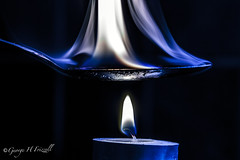 Flame (toonarmy59) Tags: flame tealight candle macromondays spoon beeswax paradegloss indoors