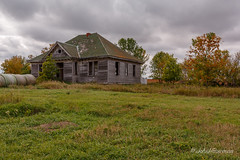 School's Out (John H Bowman) Tags: northdakota townercounty schoolbuildings countryschools abandoned derelict weatheredwood haybales fallcolor stormyskies october2014 october 2014 canon24704l