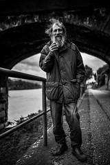 Riverside (AlphaAndi) Tags: mono monochrome urban menschen menschenbilder leute personen people trier tiefenschärfe sony face gesicht fullframe vollformat