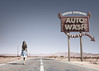 Next Exit (Fergus McNeill) Tags: desert highway road woman empty emptiness lonely sign west arid america blue sky dusty distressed forgotten