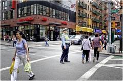 Crossroads (Steve Lundqvist) Tags: new york usa states united america manhattan stati uniti travel trip viaggio urban city urbanscape portrait ny nyc persone mood street road fujifilm x100s crossroad streetphotography nypd traffic busy rush police policeman cop cops