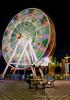 Colorful Wheel of Life (Photonistan) Tags: giantwheel lighttrails nightphotography longexposure color colour noflash explore nightshots wheel photonistan life bright night light lightpainting red fare pink love round fun
