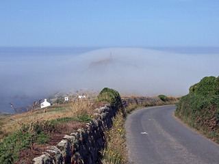 Cape Cornwall just showing through layer of sea fog