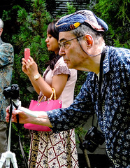 Classical look of a photographer (A. Yousuf Kurniawan) Tags: photographer streetphotography urbanlife traditional batik vintage colourstreetphotography beskap decisivemoment hobby