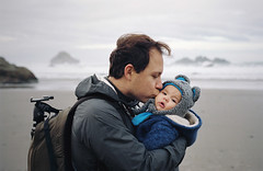 so loved (manyfires) Tags: film analog henry baby love family peoplescape portrait father son boy child kiss ocean pacificnorthwest pacificocean pnw oregon bandon sand beach shore shoreline coast coastline nikonf100 35mm michael photographer