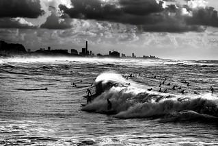 Surfing in Tel-Aviv beach