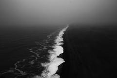Black sands and bad weather at Dyrhólaey (meezoid) Tags: black sand blackandwhite bw dyrholaey iceland vik travel fog cloud atlantic coast cool uncool cool2 cool3 uncool2 cool4 cool5 cool6 cool7 iceboxcool c7u2