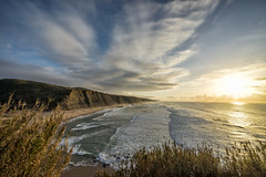 'The Importance of Place' (Canadapt) Tags: beach cliffs ocean waves grass clouds sunset magoito portugal canadapt
