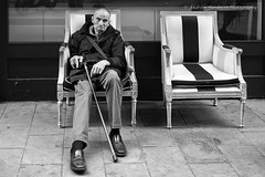 The Empty Chair (57Andrew) Tags: monochrome walkingcane chairempty fuji jpeg stare bw xt1 barcelona