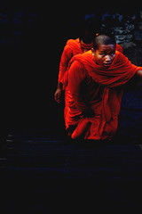 (Nas_B) Tags: asia cambodia angkorwat orange colourful monk boy travel nikon nikkor contrast stairs eyes portrait candid blue temple religion photojournalism face expression young nationalgeographic street