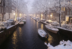Boatman passing through the white night (B℮n) Tags: amsterdam snow covered bikes bycicles holland netherlands canals winter cold wester church jordaan street anne frank house dutch people scooter gezellig cafés snowy snowfall atmosphere colorful windows walking bike cozy boat light rembrandt water canal weather cool sunset celcius mokum pakhuis grachtengordel unesco world heritage sled sleding slee seagulls meeuwen bycicle 1°c shadows sneeuw slippery glad flakes handheld wind nieuweleliestraat café denieuwelelie heineken snowman rolling sneeuwpop rollen 100faves topf100 200faves topf200 300faves topf300
