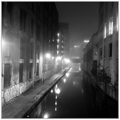 urban supernovae (vfrgk) Tags: urbanphotography urbanfragment urbanlandscape urbanview urbanbeauty foggy fog lightandshadows lights lightbeams buildings canal waterreflections water streetphotography streetsnap pathway blackandwhite monochrome bnw bw serene calm city atmospheric murk spooky mysterious