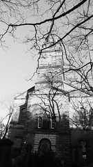 church, tree and winter shadows 01 (byronv2) Tags: church kirk saintcuthberts shadows trees winter sunlight sunny scotland architecture building history blackandwhite blackwhite newtown princesstreet lothianroad bw monochrome eglise spire tower