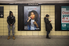 Side Glance (cookedphotos) Tags: 2018inpictures toronto ontario canada canon 5dmarkiv streetphotography ttc subway spadina station commute wait man woman glance sideways look poster advertisement 365project p3652018