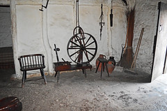 Welsh clom cottage - interior (cmw_1965) Tags: taliaris carmarthenshire mud clom cottage 18th century 1770 grade 2 listed wales welsh st fagans museum cardiff thatched straw spinning wheel stick chair flagstones whitewashed