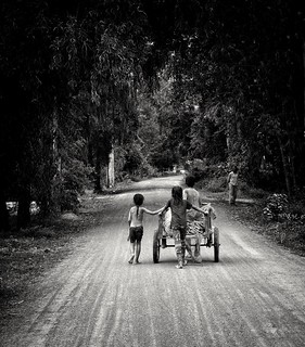 The waiting mother.... Life photography In rural Cambodia... The family kids return home after helping to crop their field