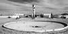 en la fuente frente al portón (rey perezoso) Tags: 2011 méxico bajacalifornia sanfelipe desert decay bw blackandwhite landscape realestate turm brunnen fountain fontana fuente day daylight cloud