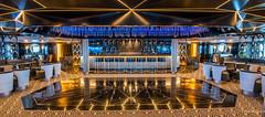 2017 - Regent Explorer - Observation Lounge (Ted's photos - For Me & You) Tags: 2017 cropped nikon nikond750 nikonfx regentcruise tedmcgrath tedsphotos vignetting reflection seating seats bar barstools lounge sevenseasexplorer emptyseats widescreen wideangle