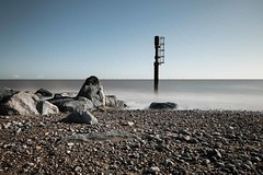 Caister Beach (Number Johnny 5) Tags: tamron d750 2470mm long turbines structures light beach imanoot windfarm desaturated exposure rusty pebbles water crusty rocks johnpettigrew colour