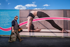 Red Line (johnjackson808) Tags: fitness shadows vancouver construction woman worker people man streetphotography fujifilmxt1 sign yoga greatnorthernway fence