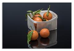Tangerine (johnhjic) Tags: johnhjic nikon d850 studio broncolor siros tangerine basket reflection colour orange green fruit light blue wood wooden water droplets flash