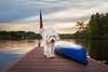 Sunset at the Lake (adventuredogphoto) Tags: dog sheepdog sheepdogmix shaggydog fluffydog canoe dock pier lake sunset reflection clouds beyondthefence adventuredogphotography blueamrich dogphotographer dogphotography dogportrait