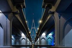 Under the Business Bay Bridge (Paul Parkinson LRPS (parkylondon)) Tags: dubai night businessbay architecture uae unitedarabemirates urban transport arches symmetry