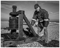 Len - Stranger 23/100 (AEChown (away now)) Tags: 100strangers stranger strangers winch mono monochrome blackandwhite fisherman beach dungeness wires grease documentary wood