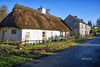 Irish Street (Canon Queen Rocks (1,870,000 + views)) Tags: cottage cottages thatched roof structure structures stonework street ireland cokilkenny landscape sky bluesky
