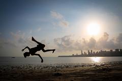 Mumbai, India (gstads) Tags: mumbai bombay india indian maharashtra jump dive beach sea ocean arabiansea skyline city sunset ngc