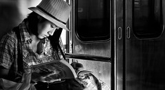 Manga reader in the Kyoto subway (Simon BOISVINET) Tags: kyoto subway manga blackandwhite photography japan voyage 2013 acros portrait
