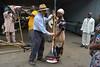 Peter Kulakwo of cassava breeding gives sweeping rake (IITA Image Library) Tags: cassava manihotesculenta cassavabreedingunit facilitymanagementunit rakes iita