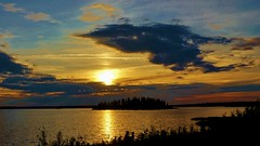 The sun is setting (krystyna p) Tags: sun island alberta canada park nationalparl elkislandnationalpark july summer silhouette silhouettes cloud clouds skies light evening blue orange color colorful water nature sony sonyilce5000 cloudy twilight dusk