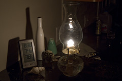 Making the Best of the Blackout (brucetopher) Tags: blackout poweroutage power energy hurricane lamp hurricanelamp flame warm glow behind glass bottles vase thermometer cold winter storm outage dark light shadow