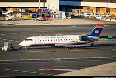 [BOS.2008] #US #ZW #AWI #WISCONSIN #CRJ200 #N460AW #AWP (CHR / AeroWorldpictures Team) Tags: us airways express air wisconsin canadair cl6002b19 regional jet crj200lr msn 7867 eng 2x ge cf343b1 reg n460aw rmk fleet number 460 history aircraft first flight test cfmnx built site montreal ymx delivered airwisconsin zw awi config cabin y50 planespotting boston logan airport 2008 sunrise plane crj bombardier ma usa nikon d80 nikkor 70300vr raw awp lightroom