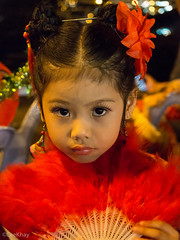 Little Miss Chiang Mai (Never.Stop.Searching.) Tags: chinese chinesenewyear festivals newyear thailand chiangmai girl red portrait faces sad