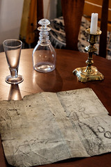Battle plans (trochford) Tags: map table candlestick carafe glass backlit stilllife munroetavern historic british colonial american revolution revolutionarywar 1775 nationalregisterofhistoricplaces lexingtonma lexingtonmassachusetts ma massachusetts newengland unitedstates us usa canon canon80d ef24105mmf4lisusm indoor concordma concordmassachusetts