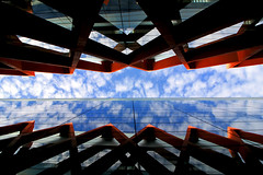 Two worlds (Daniel Nebreda Lucea) Tags: architecture arquitectura building edificio construccion nuevo new modern moderno reflection reflejo mirror espejo glass cristal shapes formas sky cielo clouds nubes perspective perspectiva composition composicion travel viajar urban urbano urbana light luz shadows sombras red rojo two dos street calle skyline edificios musseum museo art arte structure estructura blu azul sunny soleado canon 1018mm 60d burgos evolucion humana