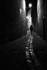 (cherco) Tags: man night solitario silhouette solitary silueta shadow sombra street shadows solo sombras composition composicion canon city ciudad calle lonely alone medieval light luz lines lampara lantern curva aloner mystery misterio r