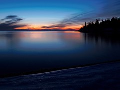 A quiet Minnesota sunrise (Jan Whybourne) Tags: sunrise lakesuperior morning blue orange still calm water beach rocks minnesota twoharbors february